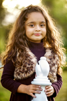 Cute girl with chess piece